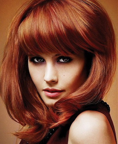 Fiery Temptress Red Medium Length Hairstyle