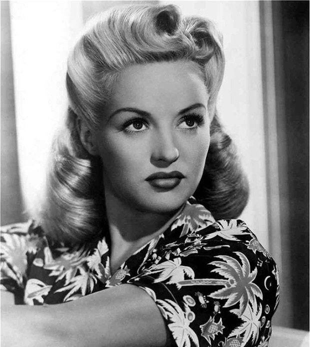 Large rolls Victory Rolls hairstyles for young girl