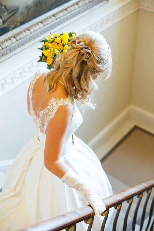 Curl arrangement half up wedding hairstyle for bride