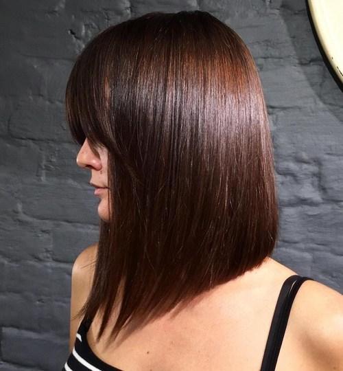 sleek heavy bangs hairstyle with auburn hair - Auburn Hair Color With Blonde Highlights