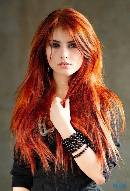 beautiful looking dark brown hair with red highlights