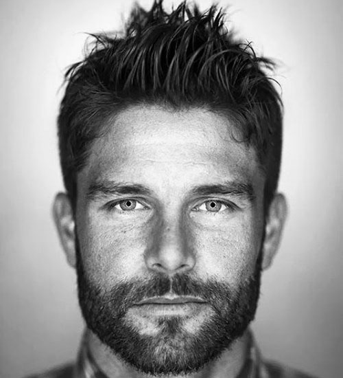 This Is A Great Faux Hawk Option For Men Who Are Not Ready For A Drastic  Style Change. There Is No Shaving Here. The Hair Is Cut Into A Low Fade And  ...