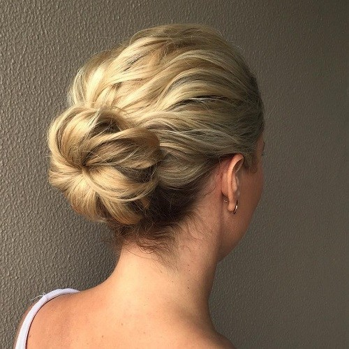 Donut bun with bangs hairstyle