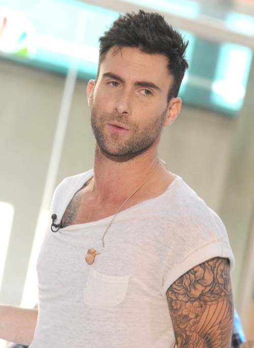 Top 10 rocktastic adam levine haircuts hairstylecamp for a slightly off kilter look like this adam levine haircut try sweeping your spikes slightly to one side with your hand the style is great for people urmus