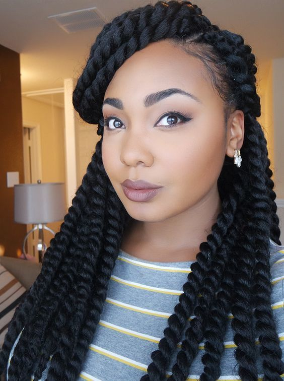 Side swept bangs hairstyle for black young girl