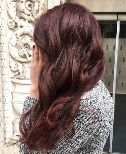 Young girl dark Auburn hair color with blond highlight