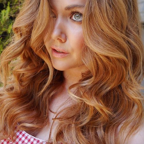 Curl with Strawberry Blonde Hair Color idea