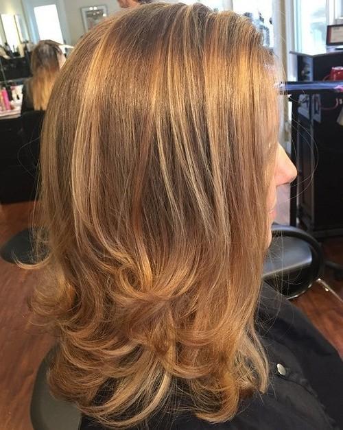Reddish blonde lowlights haircut for women