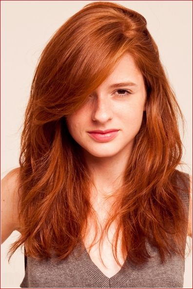 Classic auburn red hairstyle for cute girl