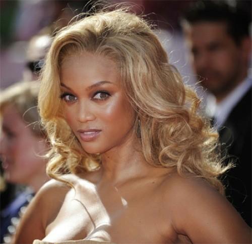 black girl golden curly hair