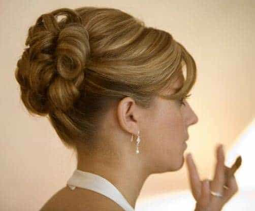 Chic High Coiled Bun for mother of the bride hairstyles