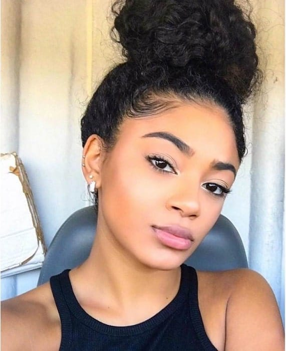 20 Amazing Curly Bun Hairstyles To Stand Out 2021 Trends