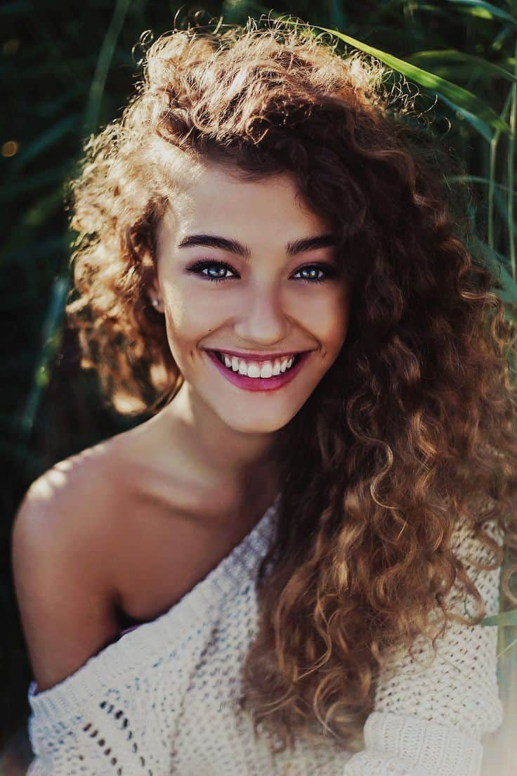 A Young Woman With Thick Curly Hair