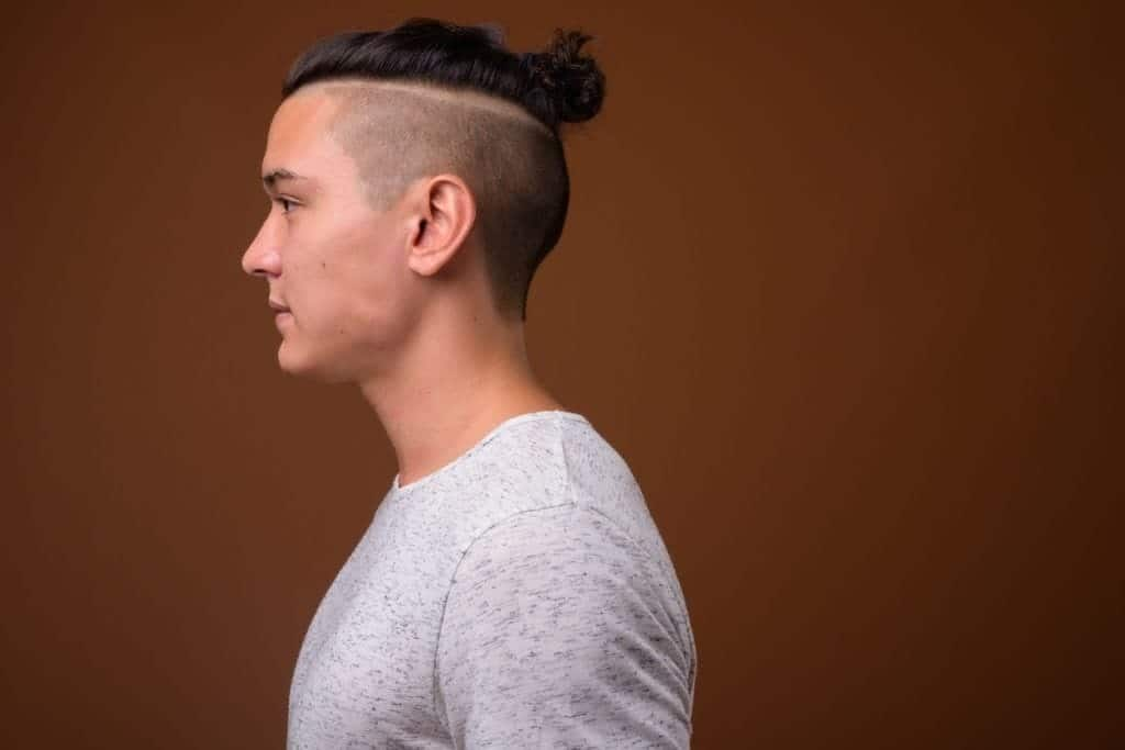 11 Suave Man Bun Hairstyles With Shaved Sides We Love