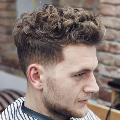 curly pompadour hairstyle with undercut