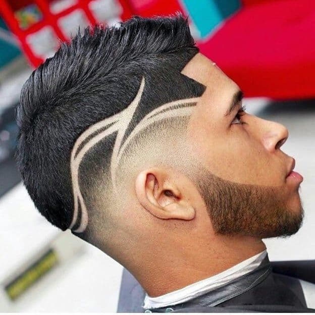 Again, it is the design that makes this taper fade haircut standout the most. A skilled barber is required to achieve this since the design is relatively ...